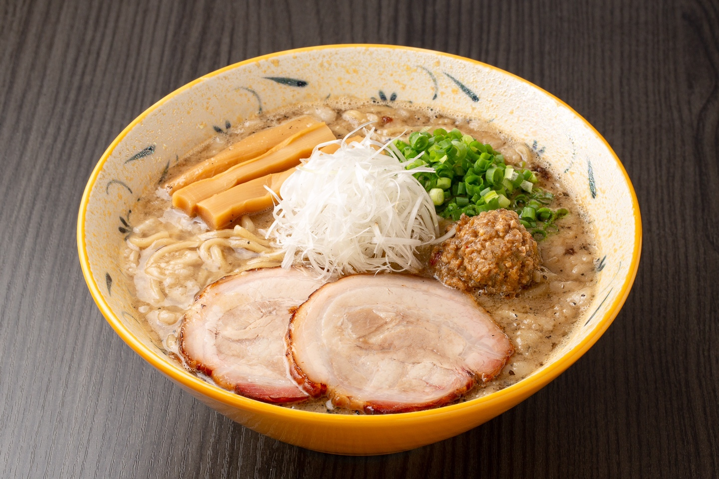 Miso Ramen made with fish stock and lard at Sapporo Fujiya. The pork fillet, roasted in a hanging pot, is extremely juicy and not to be missed!